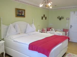 Cama ou camas em um quarto em Hotel Schneider-Gössl