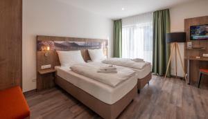 A bed or beds in a room at Holledau-Apartments Familie Gmeineder