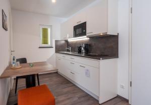 Küche/Küchenzeile in der Unterkunft Holledau-Apartments Familie Gmeineder