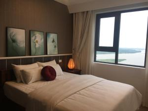 A bed or beds in a room at Riverview Suites Hanoi 1