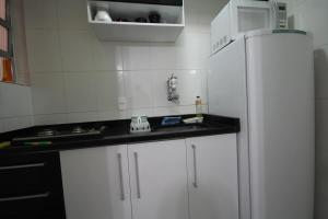 Kuchyň nebo kuchyňský kout v ubytování Apartamento Forte Copacabana
