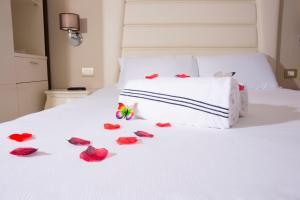 Letto o letti in una camera di Nero D'Avorio Apartments
