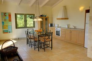 A kitchen or kitchenette at Ideales Resort