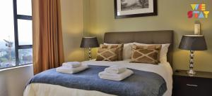 A bed or beds in a room at WeStay Westpoint Apartments