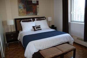 Ліжко або ліжка в номері Trylon Appartements Hotel