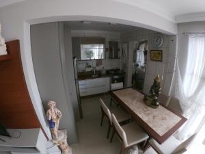 Una cocina o zona de cocina en Cobertura apartamento