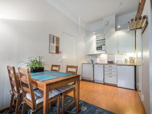 A kitchen or kitchenette at Citykoti Downtown Apartments