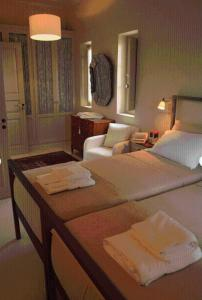 A bed or beds in a room at Liodentra