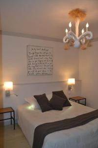 Un ou plusieurs lits dans un hébergement de l'établissement Appart's Village Trama Loges