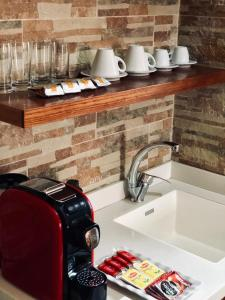 A kitchen or kitchenette at Christian Quarter Studio I