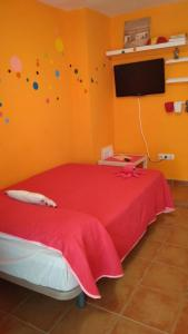 A bed or beds in a room at Studio Agata Residencial