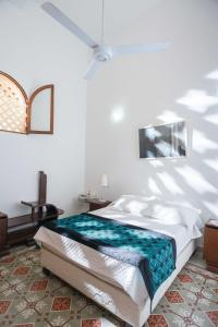 A bed or beds in a room at Colonial apartments with swimming pool, Villa Ana Maria