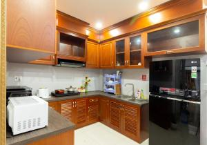 A kitchen or kitchenette at CBD Home - Home in Central - The Art