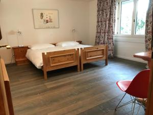 A bed or beds in a room at Suite Residence Seehof
