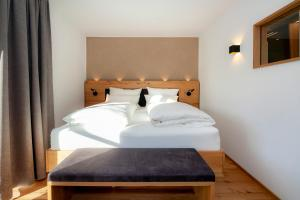 A bed or beds in a room at KRESS Living
