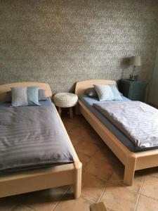 Ein Bett oder Betten in einem Zimmer der Unterkunft Ferienhaus Staben