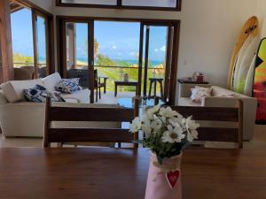 A seating area at Casa Duplex Taiba Beach Resort