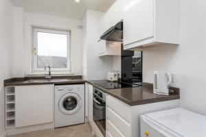 A kitchen or kitchenette at Riverside View - Donnini Apartments