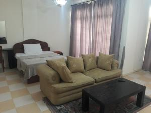 A seating area at Reem Suites