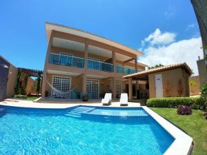 The swimming pool at or near Casa Praia Maragogi