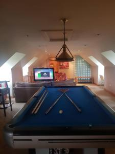 A pool table at A little piece of Heaven