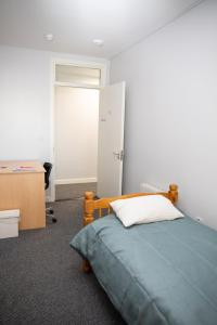 A bed or beds in a room at Cheap Accommodation close to Dublin city Center and Dublin Airport