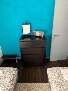 A bed or beds in a room at Casa Flor de Lis - Braga Guesthouse