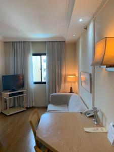 A television and/or entertainment center at ApartHotel I - Av. Paulista