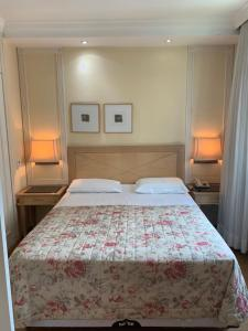 A bed or beds in a room at ApartHotel I - Av. Paulista