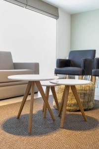 Ein Sitzbereich in der Unterkunft Belcasa Family Suites & Lofts