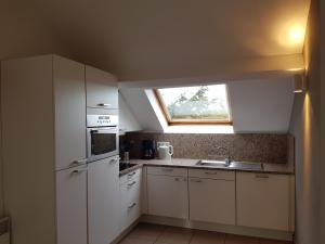 A kitchen or kitchenette at Durbuy Cosy Appart