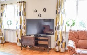 A television and/or entertainment center at Holiday home Brunnsryd M-937