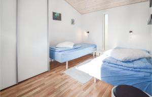 A bed or beds in a room at Le Coucou