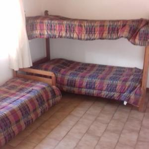 Una cama o camas cuchetas en una habitación  de casa kenya