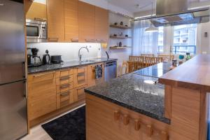A kitchen or kitchenette at Penthouse Rovaniemi