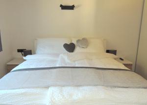 Ein Bett oder Betten in einem Zimmer der Unterkunft Apart Montis