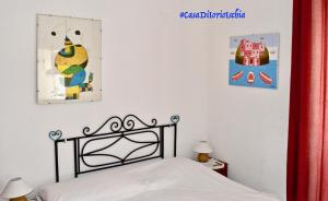 A bed or beds in a room at Casa Di Iorio Apartments Sant`Angelo
