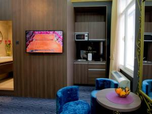 A television and/or entertainment center at Main Square Residence