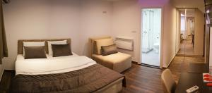 A bed or beds in a room at Olympic Apartments Wellness & Spa