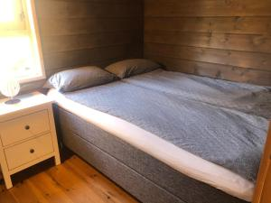 A bed or beds in a room at Classic Cabin Øvre Stordal