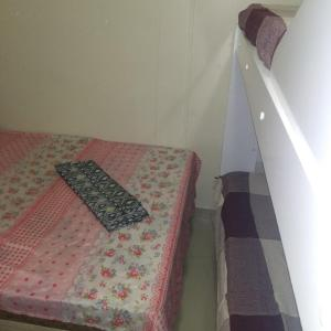 A bed or beds in a room at Cantinho de Itapuã