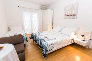 A bed or beds in a room at Villa Veca