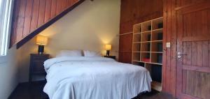 Una cama o camas en una habitación de Ski Sur Apartments