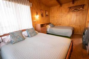 Cama o camas de una habitación en Cabañas La Posada