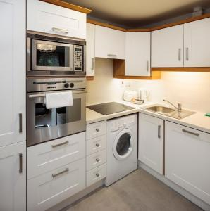 A kitchen or kitchenette at Your Home From Home Apartments