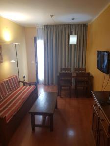 A seating area at Apartamentos Parot Quality