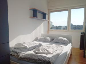 A bed or beds in a room at Apartments Zagreb Point - Centar