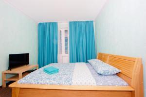 A bed or beds in a room at KvartiraSvobodna Tverskaya
