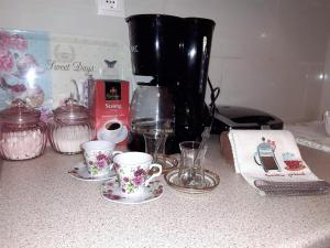 Coffee and tea-making facilities at THE BEAUTIFUL HOUSE
