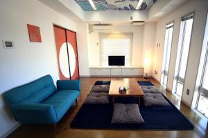 A seating area at Guest room Kamakura Nagomi -Hydrangea-